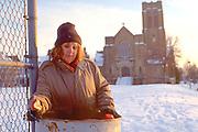 Homeless woman age 43 digging in trash.  St Paul Minnesota USA