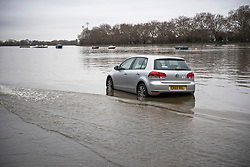 © Licensed to London News Pictures. 01/01/2018. London, UK. A car submerged as  flood water covers the roads along the embankment at Putney in West London where the River Thames has broken it's banks. Photo credit: Ben Cawthra/LNP