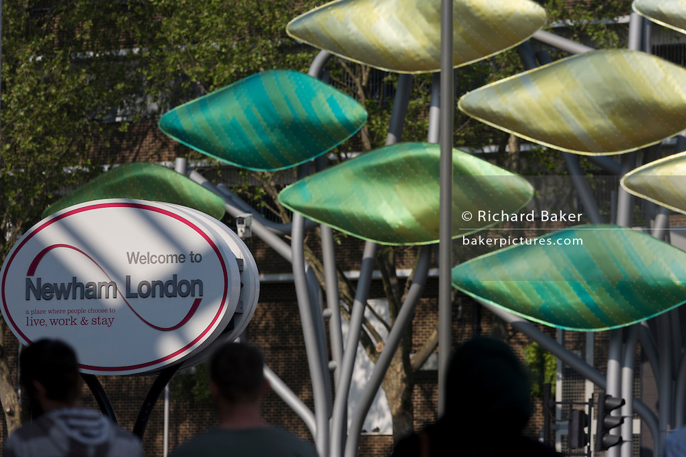 London borough of Newham sign and the new kinetic sculpture at Stratford Centre 'The Shoal' at the Stratford Centre, east London, is made up of around 100 titanium clad 'leaves' mounted between 15 and 19 metres high on metal posts. Worth £13.5m, the Shoal is part of The Stratford Town Centre Public Realm Project, designed and manufacturered using 3D technology.