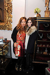 Left to right, JADE JAGGER and her daughter AMBA JACKSON at the opening of Jade Jagger's shop at 43 All Saints Road, London W11 on 25th November 2009.