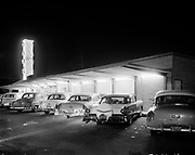 "Ackroyd 07529-11. ""J. Walter Thompson. Yaws & Irelands restaurants. March 21, 1957"" (restaurant kitchens, cooks, infra-red food servers) Yaws drive-in restaurant 2001 NE 40th"