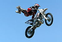 """Jul 01, 2003; Anaheim, California, USA; Moto X star athlete CHUCK CAROTHERS catches air doing a kick at Disney's California Adventure """"X Games Experience"""".  <br />Mandatory Credit: Photo by Shelly Castellano/Icon SMI<br />(©) Copyright 2003 by Shelly Castellano"""