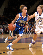 Creighton guard Michelle Kaus (22) drives against pressure from Kansas State guard Kimberly Dietz (13) in the first half at Bramlage Coliseum in Manhattan, Kansas November 13, 2006.  K-State beat the Bluejays 94-79.<br />