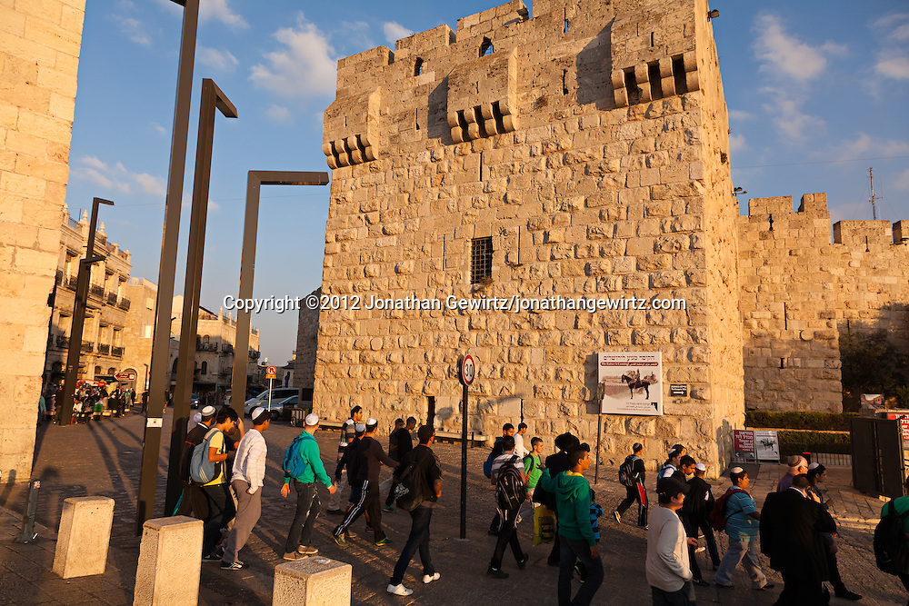 Pedestrians at the Jaffa Gate of the Old City of Jerusalem. WATERMARKS WILL NOT APPEAR ON PRINTS OR LICENSED IMAGES.