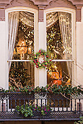 Christmas wreath on window in historic Savannah, GA.