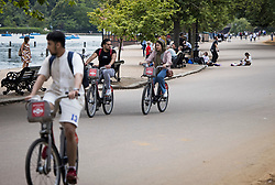 © Licensed to London News Pictures. 09/07/2021. Cyclists  in Hyde Park, central London on a summer's day. Wet and warm conditions are expected over the weekend. Photo credit: Ben Cawthra/LNP