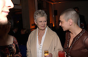 Dame Judy Dench and SinO'Connor, Fundraising party with airline theme in aid of the Old Vic and to celebrate the appointment of Kevin Spacey as artistic director.  <br />Old Billinsgate Market.  5 February 2003. © Copyright Photograph by Dafydd Jones 66 Stockwell Park Rd. London SW9 0DA Tel 020 7733 0108 www.dafjones.com