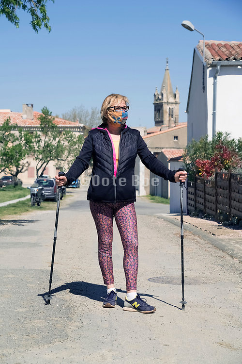 woman walking with self made mask during Covid 19 lockdown crisis France Alainge april 2020