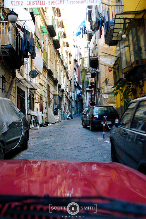 """Driving a car through the narrow alleys and """"streets"""" of Old Naples is an exciting and interesting experience.  You are almost in resident's front doors and darn near scraping the sides of parked cars.  You might have a sheet or shirt fly on to the windshield."""