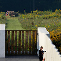 """A family members of one of the the victims of the crash Flight 93 pauses along the """"Wall of Names"""" at the Flight 93 National Memorial on the 12th 9/11 Commemoration near Shanksville,  Pennsylvania on September 11, 2013.  UPI/Archie Carpenter"""