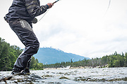 David Page keeps the pressure on a fiesty chinook salmon from BC's Dean River.