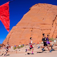 100414       Cable Hoover<br /> <br /> Racer loop around a large sandstone formation during the boys varsity race of the Gallup Invitational cross country meet at Red Rock Park Saturday.