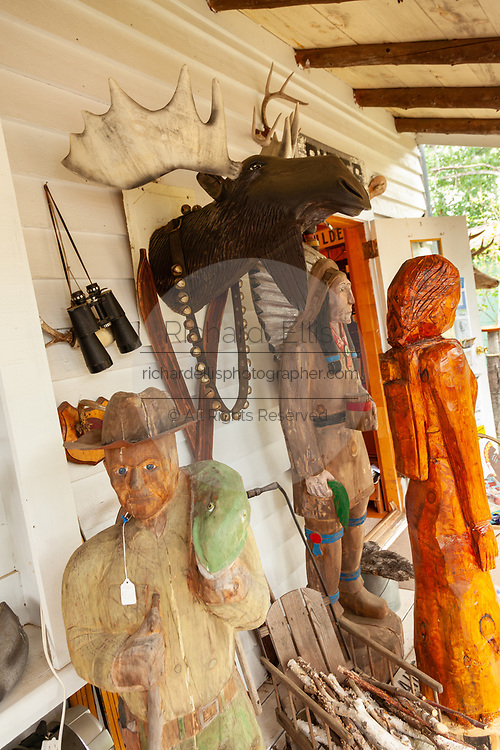 Wooden carving and taxidermy Moose at a country store in the Northwoods village of Boulder Junction, Wisconsin.