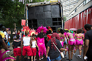 On Kensal Road, the various groups of dancers on the parade on Sunday 28th August 2016 at the 50th Notting Hill Carnival in West London. A celebration of West Indian / Caribbean culture and Europes largest street party, festival and parade. Revellers come in their hundreds of thousands to have fun, dance, drink and let go in the brilliant atmosphere. It is led by members of the West Indian / Caribbean community, particularly the Trinidadian and Tobagonian British population, many of whom have lived in the area since the 1950s. The carnival has attracted up to 2 million people in the past and centres around a parade of floats, dancers and sound systems.