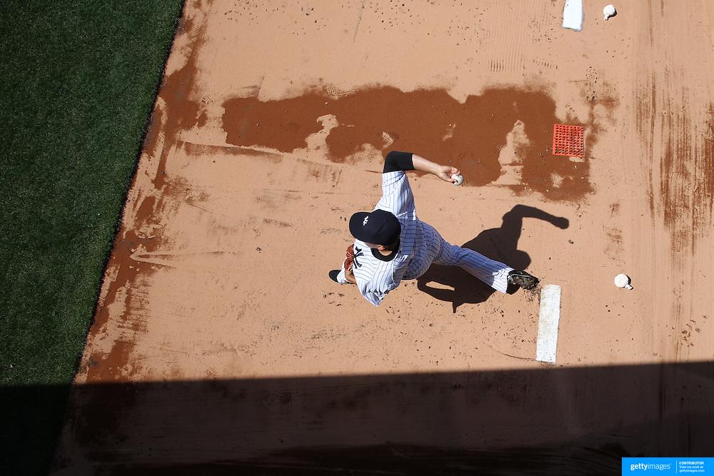 Pitcher Masahiro Tanaka, New York Yankees, warming up in the bull pen before the New York Yankees Vs Toronto Blue Jays season opening day at Yankee Stadium, The Bronx, New York. 6th April 2015. Photo Tim Clayton