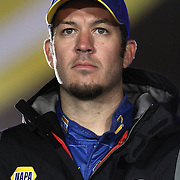 NASCAR Sprint Cup driver Martin Truex Jr. is seen during the driver introductions prior to the NASCAR Sprint Unlimited Race at Daytona International Speedway on Saturday, February 16, 2013 in Daytona Beach, Florida.  (AP Photo/Alex Menendez)
