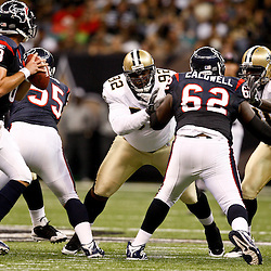 August 21, 2010; New Orleans, LA, USA; New Orleans Saints defensive tackle Remi Ayodele (92) and defensive end Alex Brown (96) work against Houston Texans center Antoine Caldwell (62) as they put pressure on quarterback Matt Schaub (8) during the first quarter of a preseason game at the Louisiana Superdome. Mandatory Credit: Derick E. Hingle