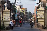 Traffic passes the gates to the town of Chandannagar bearing the French inscription, Liberte, Egalite, Fraternite. Chandannagar, India
