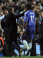 Photo: Paul Thomas.<br /> Chelsea v Valencia. UEFA Champions League. Quarter Final, 1st Leg. 04/04/2007.<br /> <br /> Manager of Chelsea Jose Mourinho (L) congratulates goal scorer Didier Drogba as he comes off the field at the end of the match.