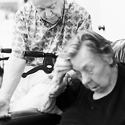 Ivan Mahoney visits his wife, Dot, at The Woods Retirement Center where she now lives, due to the ravages of Alzheimer's Disease on Tuesday, Sept. 13, 2011.