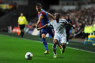 Swansea city's Wayne Routledge makes a break.  Barclays Premier league, Swansea city v Crystal Palace match at the Liberty Stadium in Swansea, South Wales on Sunday 2nd March 2014.<br /> pic by Andrew Orchard, Andrew Orchard sports photography.