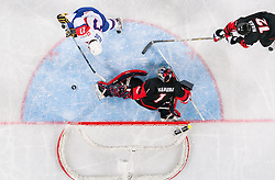 Rok Pajic of Slovenia vs Masahito Haruna and Yosuke Haga of Japan during ice-hockey match between Slovenia and Japan at IIHF World Championship DIV. I Group A Slovenia 2012, on April 16, 2012 in Arena Stozice, Ljubljana, Slovenia. Slovenia defeated Japan 4-2. (Photo by Vid Ponikvar / Sportida.com)