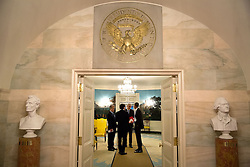 President Barack Obama talks with Chief of Staff Denis McDonough, Jason Furman, Chair, Council of Economic Advisers and National Economic Council Director Jeffrey Zients in the Diplomatic Reception Room of the White House, Oct. 29, 2014. (Official White House Photo by Pete Souza)<br /> <br /> This official White House photograph is being made available only for publication by news organizations and/or for personal use printing by the subject(s) of the photograph. The photograph may not be manipulated in any way and may not be used in commercial or political materials, advertisements, emails, products, promotions that in any way suggests approval or endorsement of the President, the First Family, or the White House.