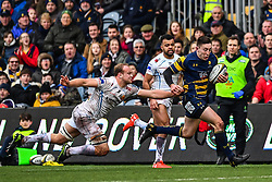 Josh Adams of Worcester Warriors evades the tackle of David Denton of Worcester Warriors - Mandatory by-line: Craig Thomas/JMP - 27/01/2018 - RUGBY - Sixways Stadium - Worcester, England - Worcester Warriors v Exeter Chiefs - Anglo Welsh Cup