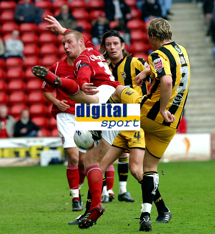 Photo: Dave Linney.<br />Walsall v Port Vale. Coca Cola League 1. 15/04/2006.<br />Walsall's James Constable(L) gets in a block where it hurts to deny Craig James