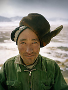 Portrait Kelt Baig, whose wife lost 9 child out of 10 pregnancies. Wearing hat in a Kyrgyz manner..Campment of Sary Tash..Winter expedition through the Wakhan Corridor and into the Afghan Pamir mountains, to document the life of the Afghan Kyrgyz tribe. January/February 2008. Afghanistan