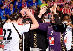 Cvijic Dragana of Krim and Goalkeeper of Krim Jelena Grubisic  at handball match of Round 5 of Champions League between RK Krim Mercator and Metz Handball, France, on January 9, 2010 in Kodeljevo, Ljubljana, Slovenia. (Photo by Vid Ponikvar / Sportida)