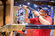 15 MAY 2009 -- PHOENIX, AZ: Emil Lobosco (CQ) from Phoenix, handles a replica of a Colt Lightning slide action rifle in the Stoeger Arms booth Friday. More than 60,000 people are expected to attend the NRA convention and annual meeting, which is being held at the Phoenix Convention Center through Sunday. This is the 138th annual meeting of the National Rifle Association.  Photo by Jack Kurtz