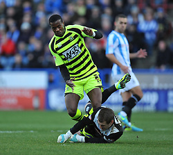 Huddersfield Town's Alex Smithies tackles Yeovil Town's Ishmael Miller - Photo mandatory by-line: Alex James/JMP - Tel: Mobile: 07966 386802 29/12/2013 - SPORT - FOOTBALL - John Smith's Stadium - Huddersfield - Huddersfield Town v Yeovil Town - Sky Bet Championship