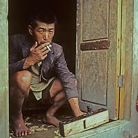 A carpenter works on a wood door in Namche Bazar, Nepal.