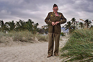 """12/7/99 Al Diaz/Herald Staff-- WWII Memorial ceremony and Pearl Harbor remembrance on Miami Beach. """"I have returned"""" says Edward Gibbons of Texas as he buttoned his military uniform for a picture. Gibbons served as a seargent on the Army Air Corp and is back on Miami Beach for the first time since he trained and lived on Ocean Drive, Miami Beach, during the war."""