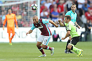 Gokhan Tore of West Ham United goes past Ryan Fraser of AFC Bournemouth. Premier league match, West Ham Utd v AFC Bournemouth at the London Stadium, Queen Elizabeth Olympic Park in London on Sunday 21st August 2016.<br /> pic by John Patrick Fletcher, Andrew Orchard sports photography.