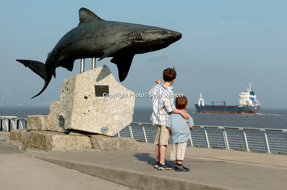 8 June 2006: Two young boys look at a ship on the River Humber from The Deep, Hull...Picture:Sean Spencer/Hull News & Pictures 01482 210267/07976 433960..High resolution picture library at http://www.hullnews.co.uk..©Sean Spencer/Hull News & Pictures Ltd..NUJ recommended terms & conditions apply. Moral rights asserted under Copyright Designs & Patents Act 1988. Credit is required. No part of this photo to be stored, reproduced, manipulated or transmitted by any means without permission. ..