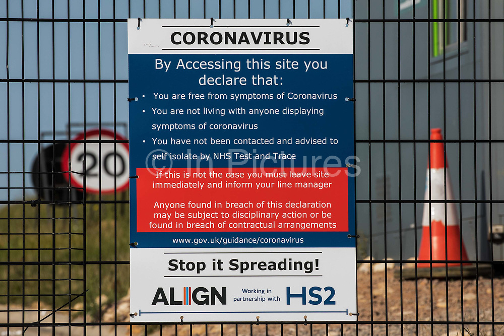 A coronavirus warning notice at the entrance to the South Portal site for the HS2 high-speed rail link is pictured on 14 September 2020 in West Hyde, United Kingdom.