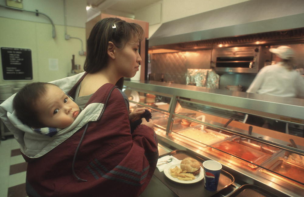 Lunchtime at Ilisagvik College cafeteria, the northermost place you can buy a bite to eat in America.<br /> Michelle Weyiouanna carries her baby Esau in the eskimo style.<br /> May 15, 12:12