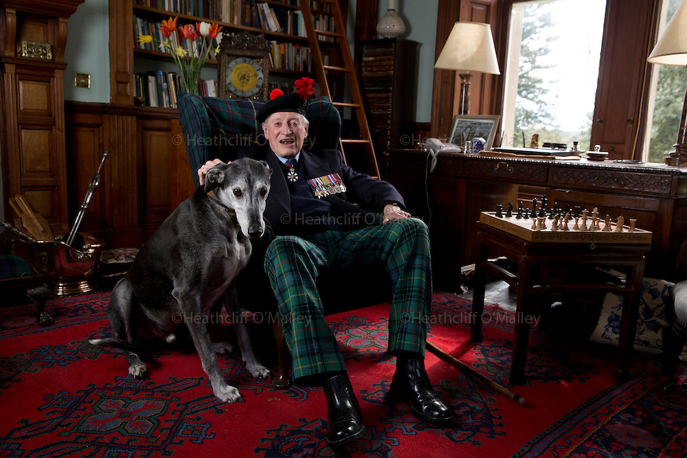 """Mcc0061428 . Daily Telegraph<br /> <br /> Telegraph Magazine<br /> <br /> D Day Veterans<br /> <br /> Brian Stewart with his Lurcher """"Torquil """".<br /> <br /> Brian Stewart CMG, served as a Lieutenant in the 1st Battalion Tyneside Scottish, The Black Watch and was  second in command of an anti tank platoon in Normandy . On 1st July 1944 he was seriously wounded and evacuated after his half dozen six pounder guns destroyed 12 German tanks during the battle of Rauray .<br /> His son Rory Stewart is a former diplomat and now a Conservative MP in Cumbria .<br /> <br /> Crief, 29 April 2015"""