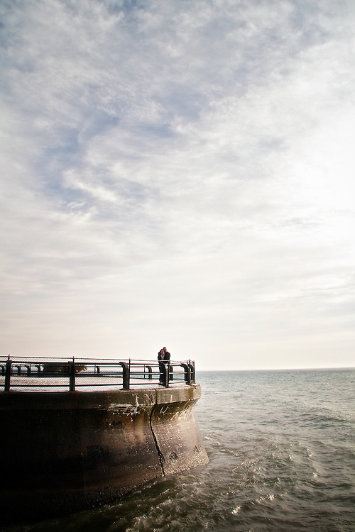 A man and woman stand on the pier situated on the grounds of the R.C. Harris Water Treatment Plant. This plant provides safe drinking water to Toronto's residents and York Region.