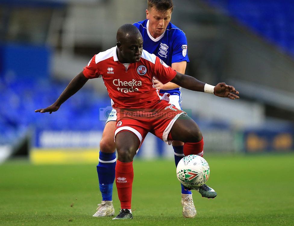 Birmingham City's Stephen Gleeson and Crawley Town's Kaby Djalo (front) battle for the ball