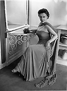 17/05/1956<br /> 05/17/1956<br /> 17 May 1956<br /> Special for Leslie Luke. Joan Castle wearing a gown by Irene Gilbert at Irene Gilbert's salon at 22 South Frederick Street, Dublin.