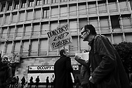 Occupy movement demonstration on Paradeplatz, outside the headquarters of UBS, 'Democracy not plutocracy' slogan.
