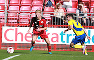 Crawley Town defender Christian Scales, on loan from Crystal Palace takes on Accrington Stanley midfielder Piero Mingoia during the Sky Bet League 2 match between Crawley Town and Accrington Stanley at the Checkatrade.com Stadium, Crawley, England on 26 September 2015. Photo by Bennett Dean.