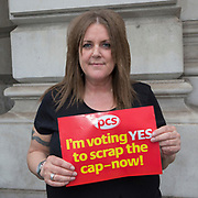 Tracey Wickes,  HMRC, 100 Parliament Street. PCS members working in the civil service are holding a short, high profile protest to demonstrate about the continued 1% pay cap public sector pay cap that has been in place for 7 years.Westminster,  London,  United Kingdom. (Photo by Andy Aitchison / PCS)