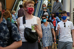 © Licensed to London News Pictures. 15/07/2021. Edinburgh, Scotland, UK.  Commuters at Edinburgh Waverley station wearing face coverings. From Monday 19 July, wearing face coverings on public transport in England will no longer be a legal requirement. However, passengers travelling in Scotland and Wales will be required to wear face coverings on public transport beyond July 19. Photo credit: Dinendra Haria/LNP