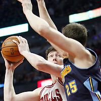 26 March 2012: Denver Nuggets center Timofey Mozgov (25) defends on Chicago Bulls center Omer Asik (3) during the Denver Nuggets 108-91 victory over the Chicago Bulls at the United Center, Chicago, Illinois, USA. NOTE TO USER: User expressly acknowledges and agrees that, by downloading and or using this photograph, User is consenting to the terms and conditions of the Getty Images License Agreement. Mandatory Credit: 2012 NBAE (Photo by Chris Elise/NBAE via Getty Images)