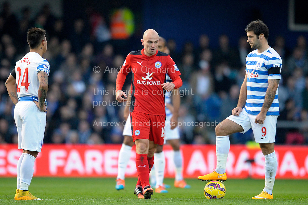 Esteban Cambiasso of Leicester City walking back to the centre half after scoring his teams first goal of the game to make it 1-0, (l) Eduardo Vargas of Queens Park Rangers and (r) Charlie Austin of Queens Park Rangers look on. Barclays Premier league match, Queens Park Rangers v Leicester city at Loftus Road in London on Saturday 29th November 2014.<br /> pic by John Patrick Fletcher, Andrew Orchard sports photography.