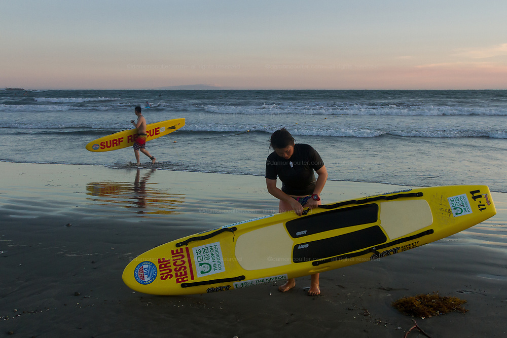 Life guards pack up their surf rescue boards at the end of the day on Kamakura Beach, Kanagawa, Japan. Thursday August 8th 2019